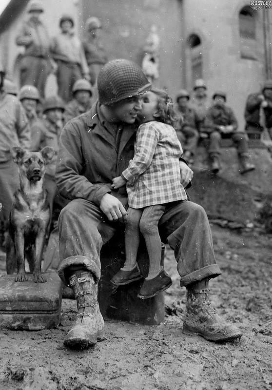 american soldier getting a little love after the liberation of italy