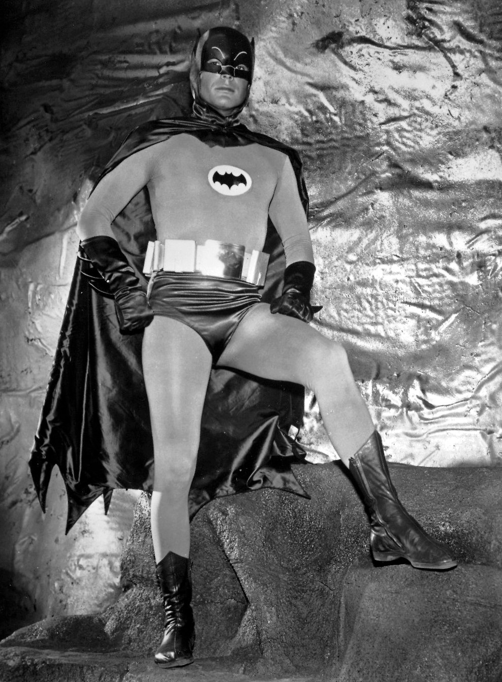 Adam West as Batman, showing some leg