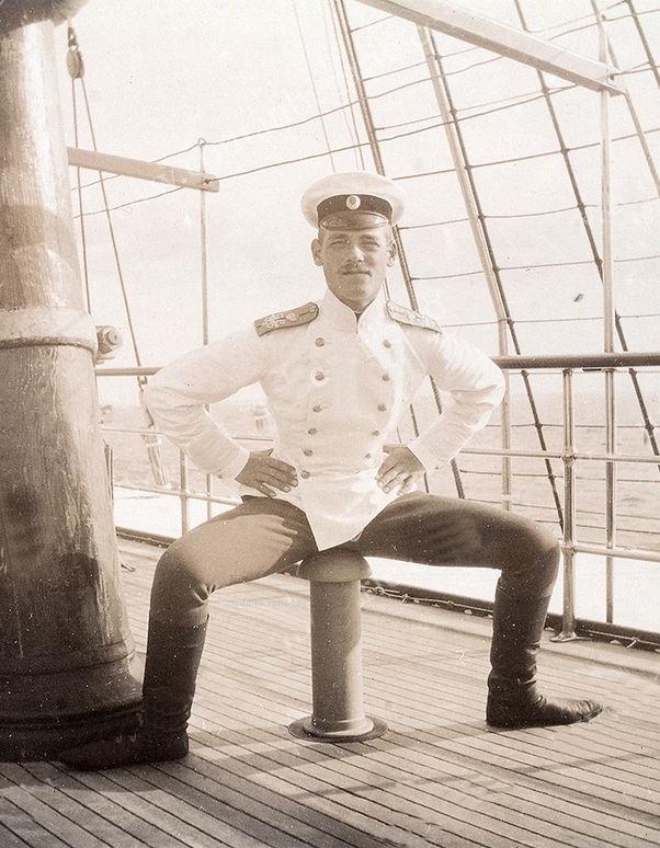 Grand Duke Mikhail of Russia, sitting suggestively on aphallus