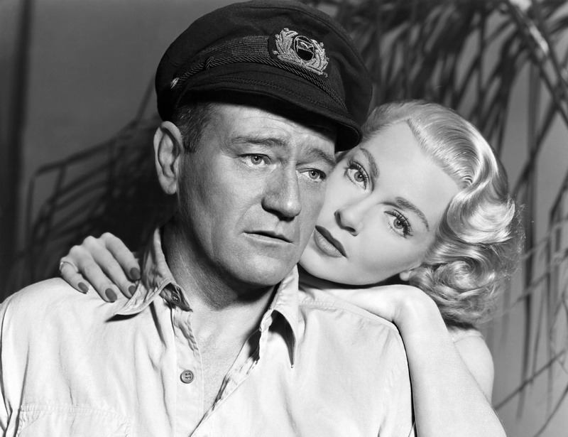 "John Wayne and Lana Turner in a promo shot for ""The Sea Chase"", 1955"