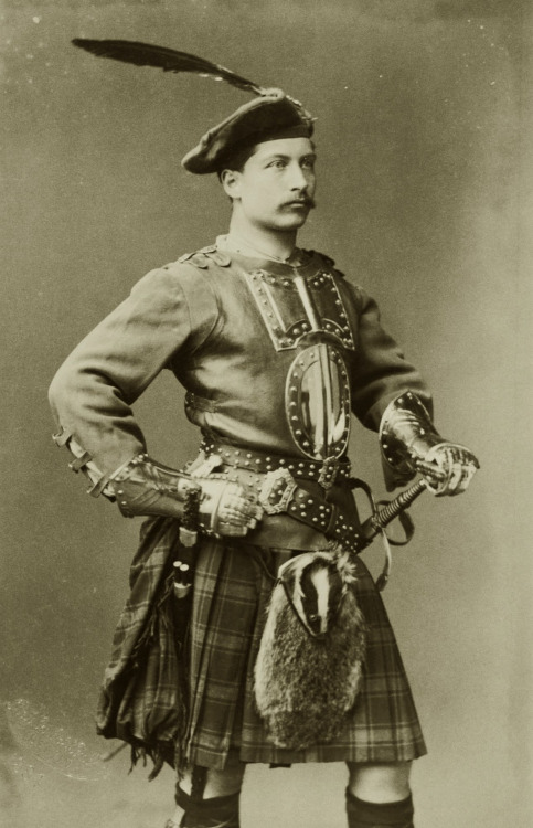 Kaiser Wilhelm II in a kilt and with a feather in hischapeau