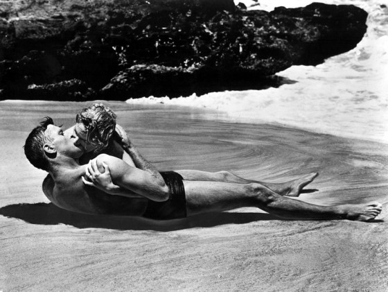"""Burt Lancaster and Deborah Kerr, shown here in a famous scene still from the 1953 Academy Award®-winning film """"From Here to Eternity,"""" both received Oscar® nominations for their roles in the film.  Lancaster was nominated in the Best Actor category for his portrayal of Sgt. Milton Warden while Kerr received a Best Actress nomination for her role of """"Karen Holmes."""" The film received 13 nominations in total and won eight Oscars® including Best Picture. Restored by Nick & jane for Dr. Macro's High Quality Movie Scans Website: http:www.doctormacro.com. Enjoy!"""