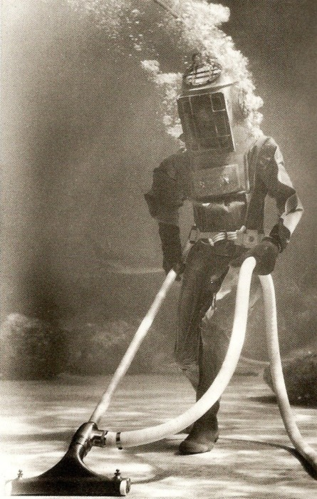 Old fashioned diving suit andvacuum