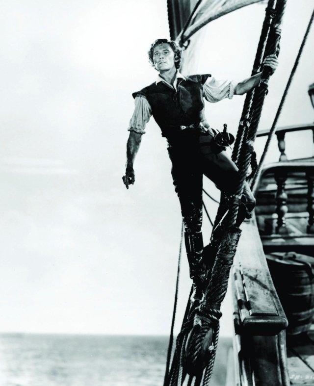 Errol Flynn, inmid-swashbuckle