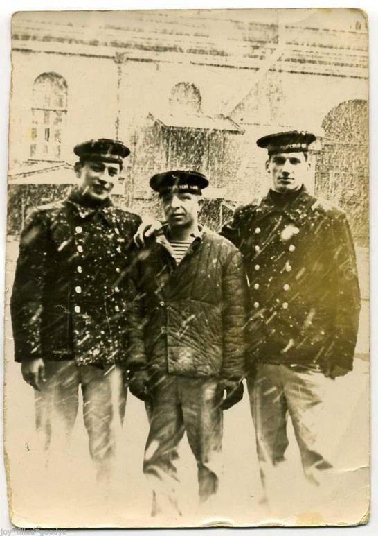 Vintage sailors together in a snowstorm