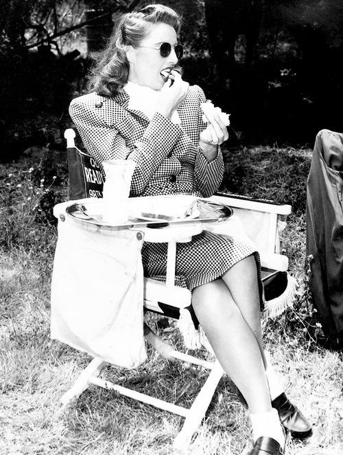 Barbara Stanwyck having a nosh on theset