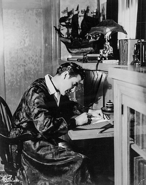 John Gilbert at his writing desk,1926