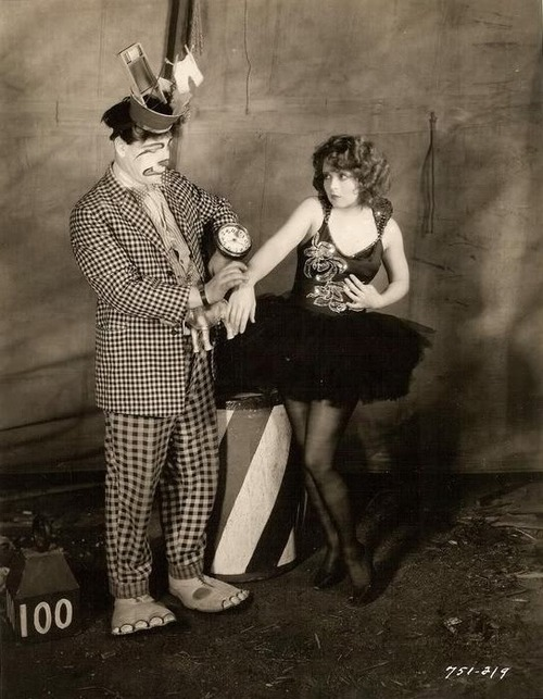 Clara Bow and some freaky clown in an old silent movie