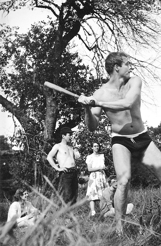 Marlon Brando in a swimsuit  playing baseball with friends,1953