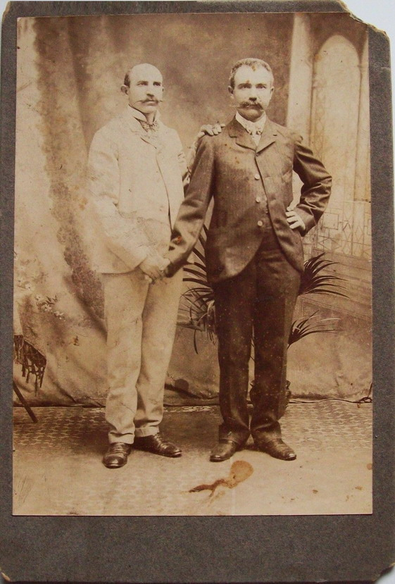 Vintage men with staches having their photo takentogether