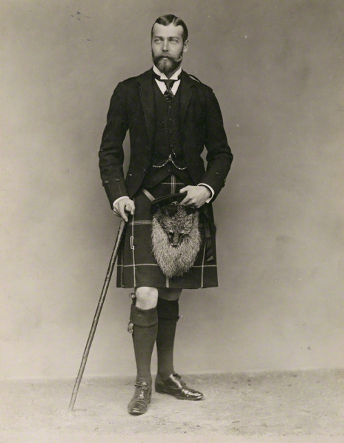 King George V showing his knees and wearing a fox crotch-warmer.