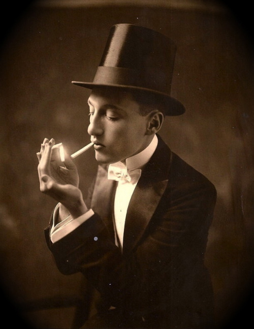 Top hat, white tie, and cigartette
