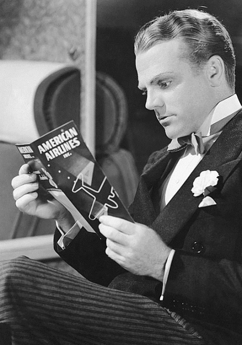 James Cagney reading the emergency instructions card on an American Airlines plane,1930s