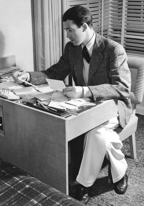 jimmy-stewart-looking-at-his-fan-mail-after-making-the-mortal-storm-1940