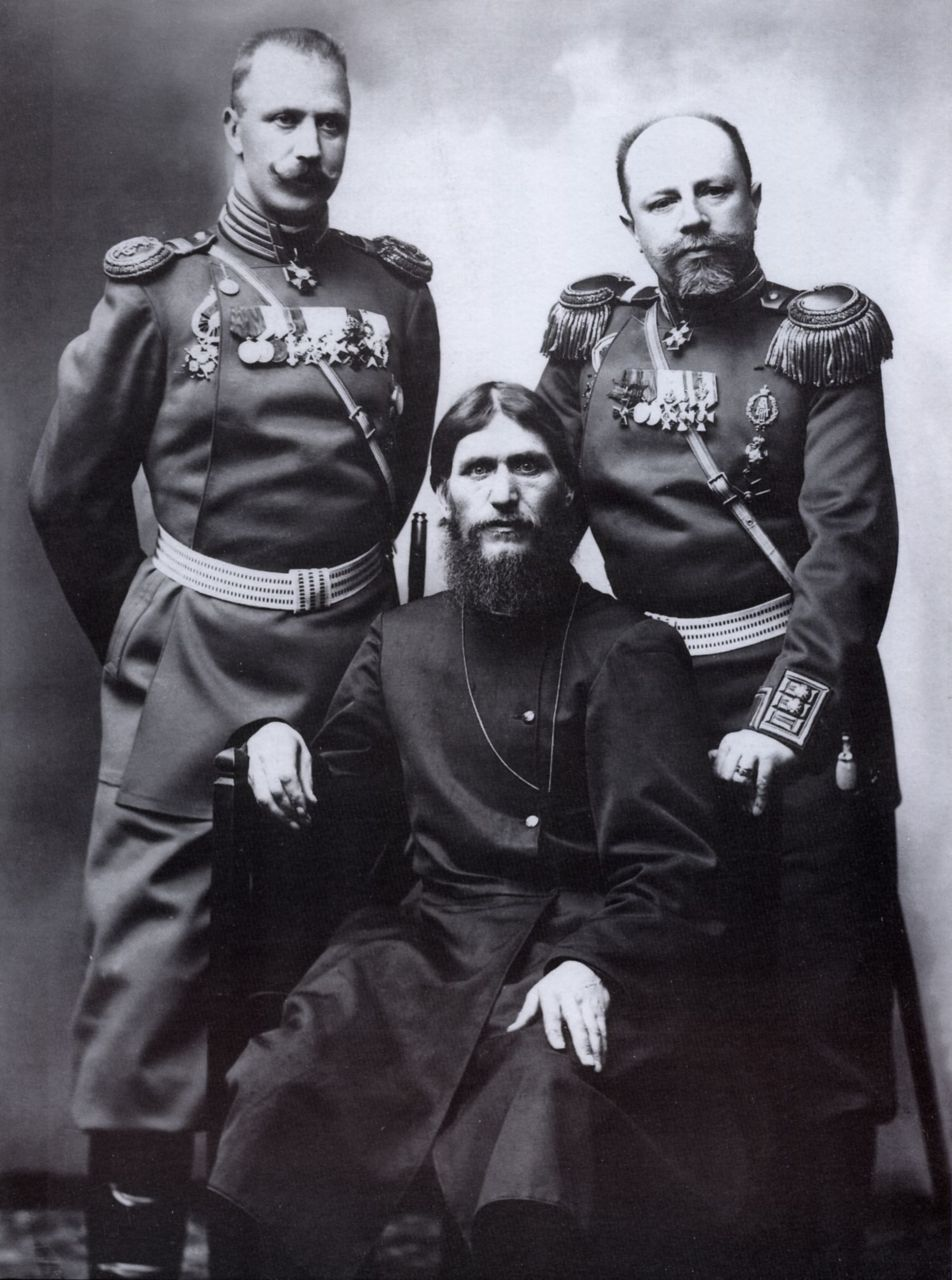 Rasputin posing with two Russian generals