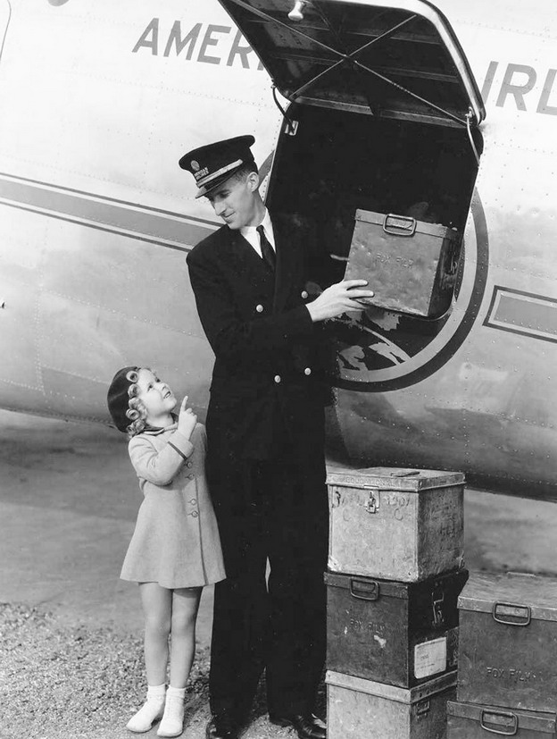 Shirley Temple receiving boxes of fan mail