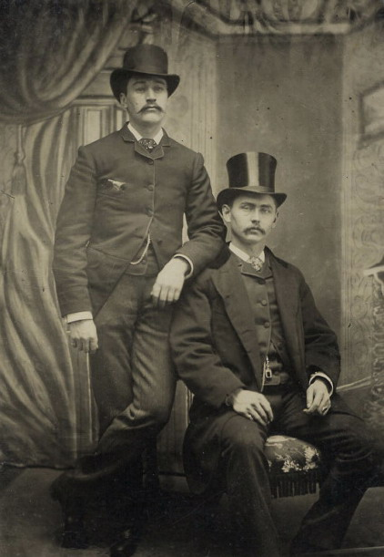 Vintage Men Together, with moustaches andhats