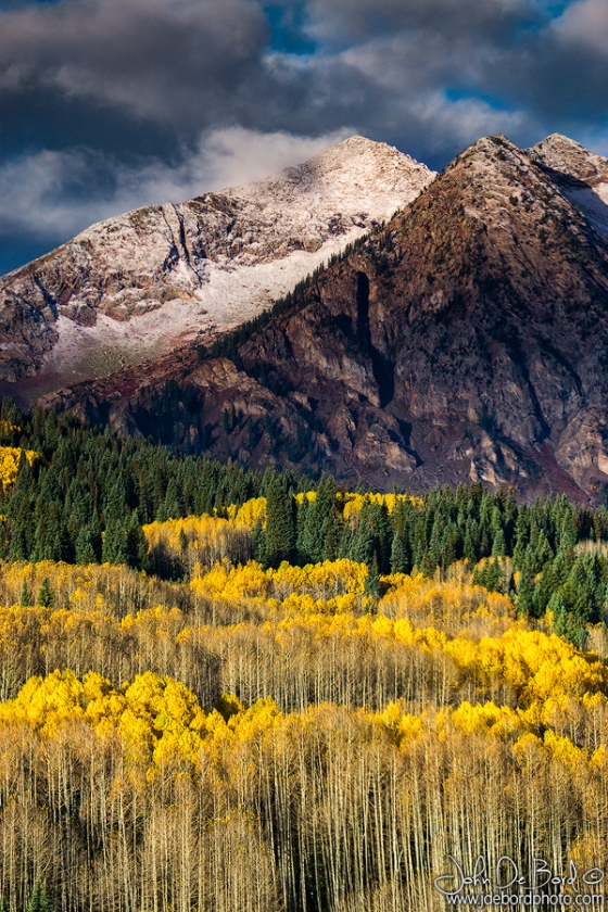 The peaks of the West Elk Mountains along Kebler Pass in Colorado show off a fresh dusting of snow during autumn