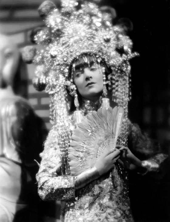 circa 1935: American actress Myrna Loy wearing an elaborate Balinese costume in a scene from an unknown film.