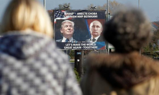 A billboard showing a pictures of President-elect Donald Trump and Russian President Vladimir Putin is seen through pedestrians in Danilovgrad, Montenegro. REUTERS/Stevo Vasiljevic