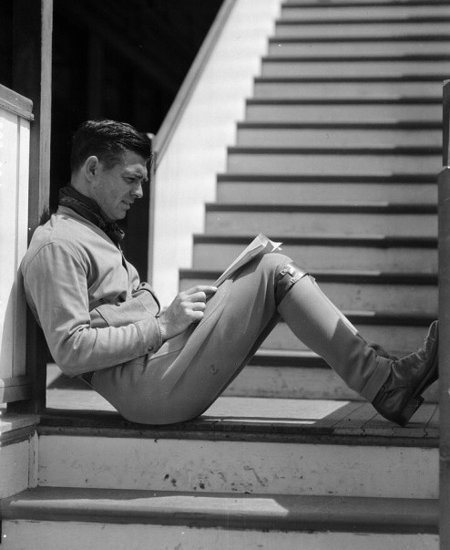 Clark Gable studying a script