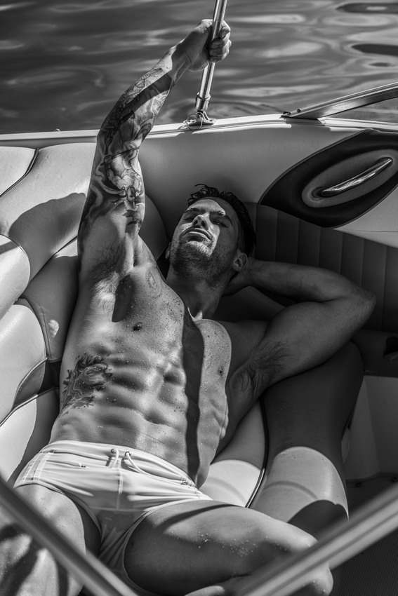 Gratuitous Shirtless Model in a Boat