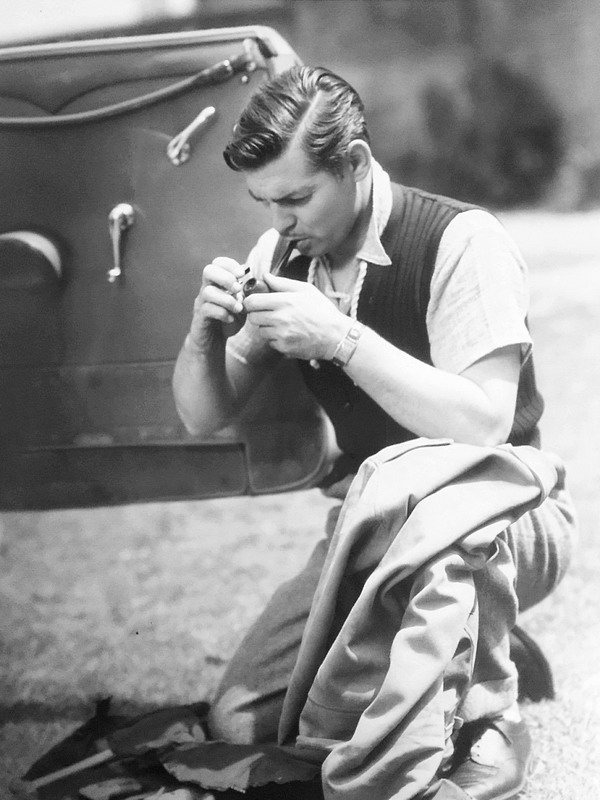 Clark Gable, lighting a pipe