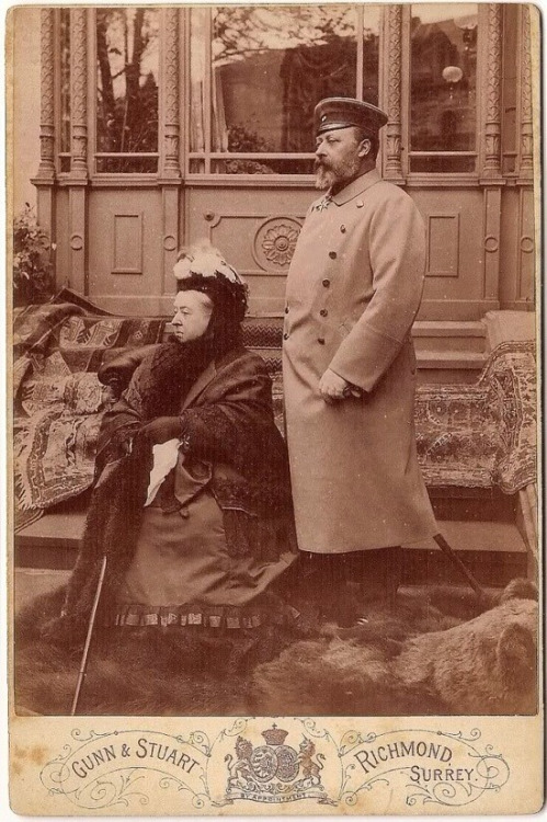Queen Victoria and Prince Edward (later King Edward), on a bearrug