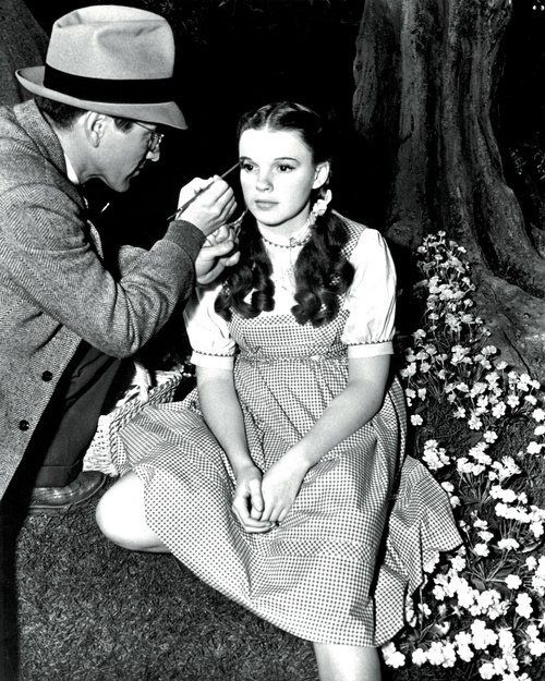 "Judy Garland getting a little touch up during the filming of ""The Wizard of Oz"""
