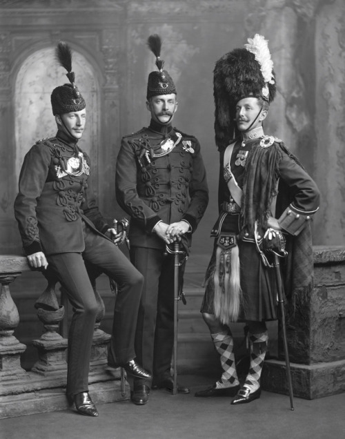 Three mustachioed soldiers, British I assume, with some funhats