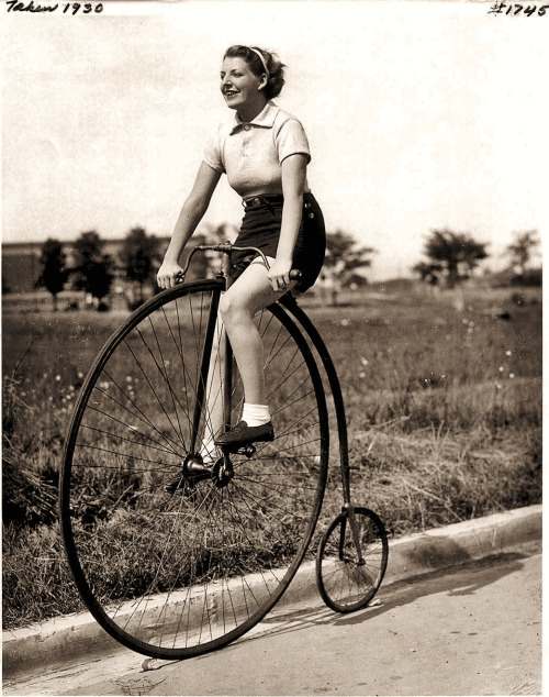 Woman riding a Penny Farthing, 1930