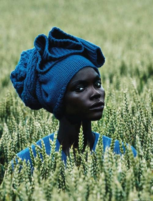 African woman in a field of millet