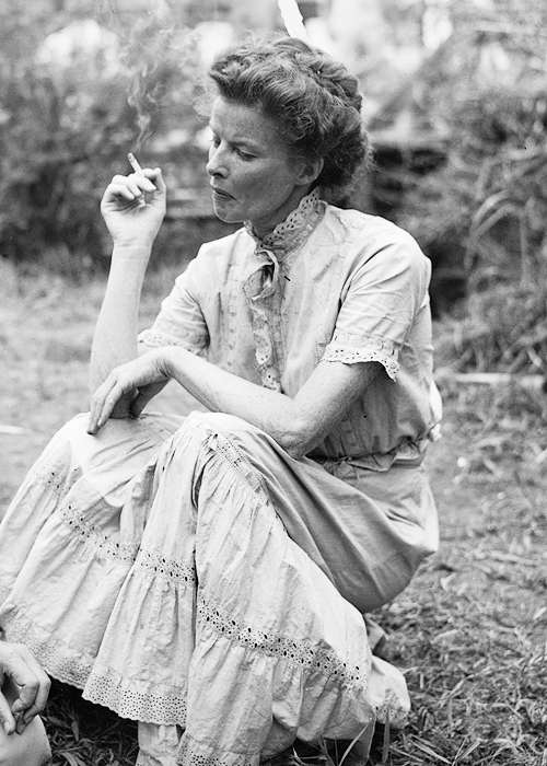 "Katharine Hepburn taking a smoke break during the filming of ""The African Queen"""