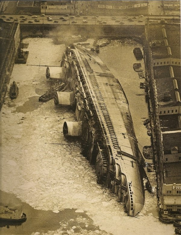 SS Normandie after it caught fire and rolled over at a pier in NYC, 1945