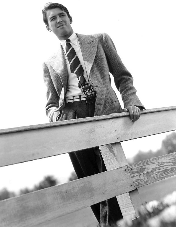 Young Jimmy Stewart, leaning upon afence