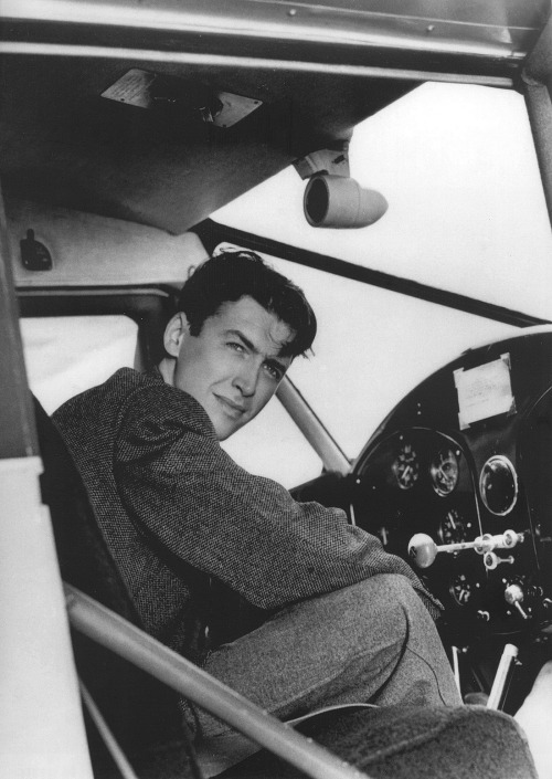 Young Jimmy Stewart at the controls of a smallplane
