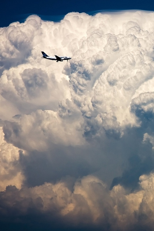 Plane and clouds