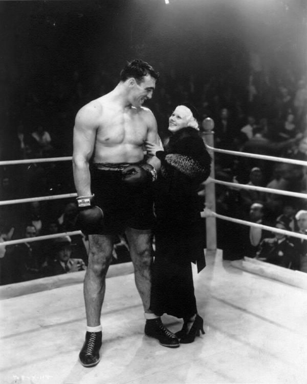 Jean Harlow admiring a big, strapping boxer (1930s)