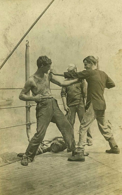 Sailors sparring on deck