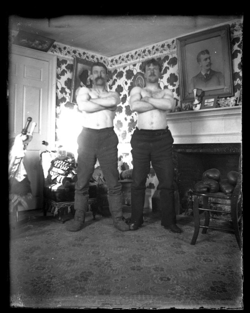 Two shirtless burly vintage Russianmen