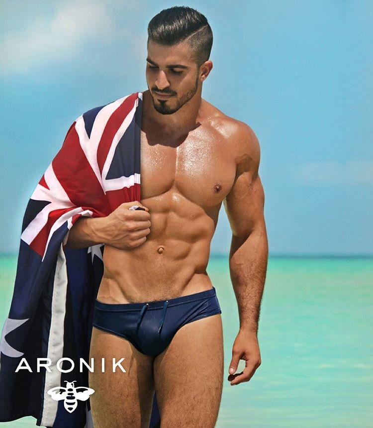 Aronik swimwear model with an Australianflag