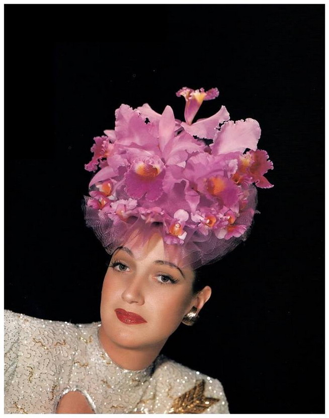 Dorothy Lamour working someorchids
