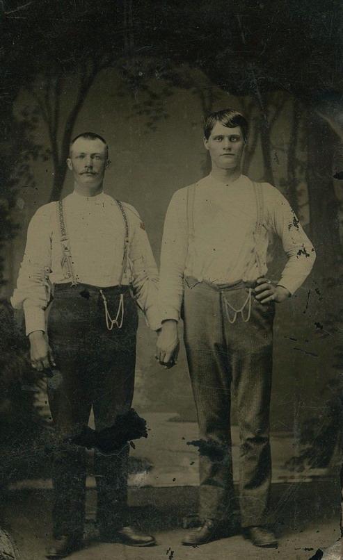 Men together holdinghands