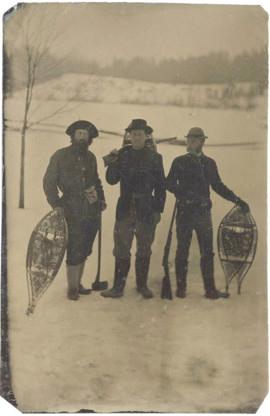 Teddy Roosevelt (center), before he became president, on a hunting trip in Maine