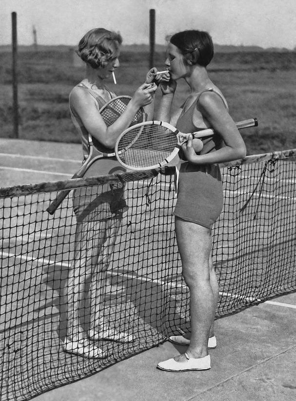 Smoke break on the tennis court,1920s