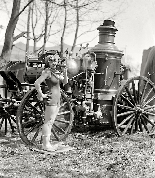 Silent film star Beatrice Kyle with an old fashioned fire truck, 1924