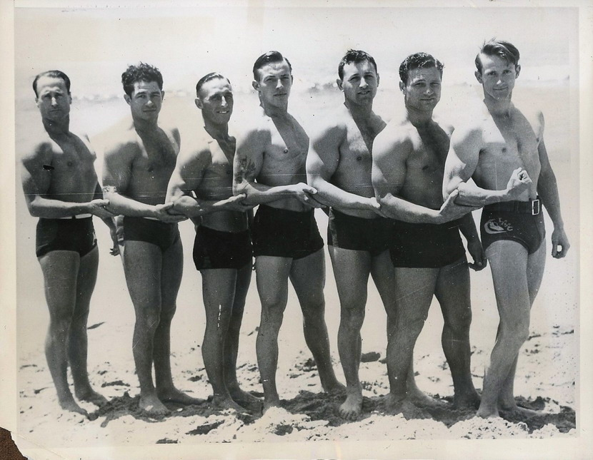 Vintage muscle men at the beach
