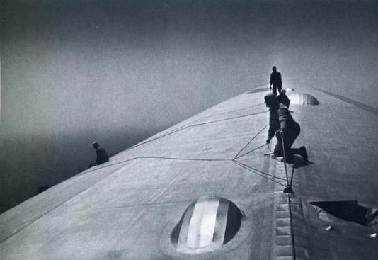 German officers fixing a hole on the top of the Graf Zeppelin WHILE FLYING OVER THE ATLANTIC,1930s