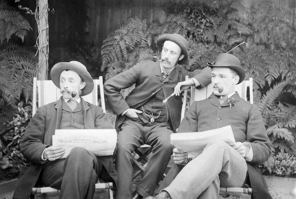 Three Men Together – smoking pipes, wearing hats, and proudly moustachioed