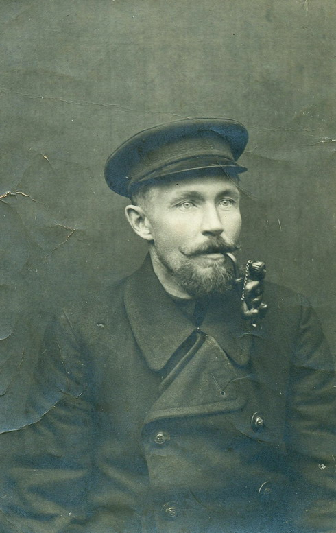 Man smoking an unusual pipe